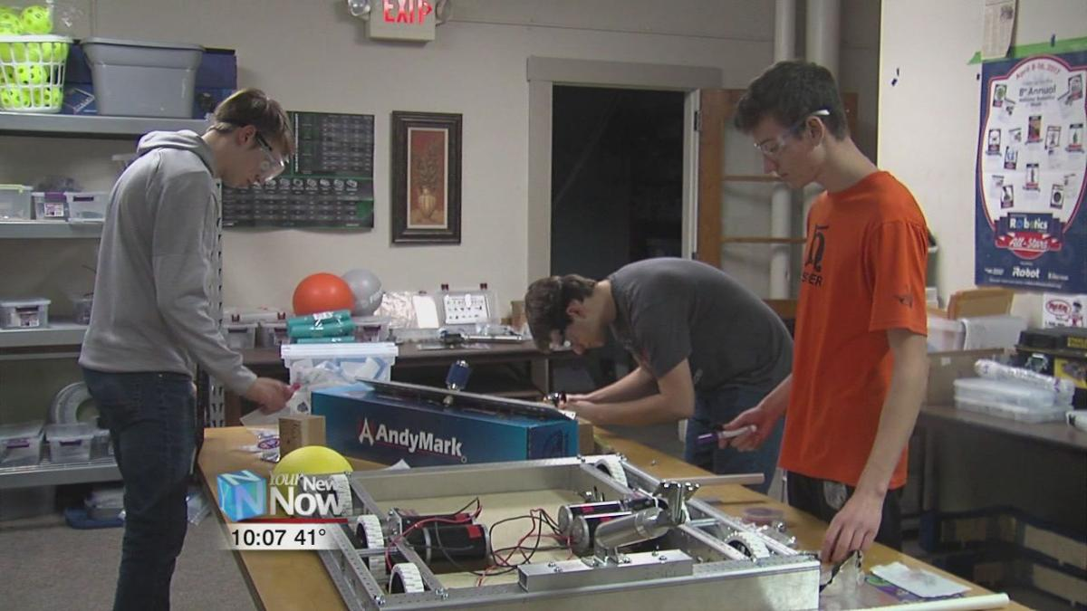 PPG Coatings Services donates $5000 to Lima YMCA's robotic team