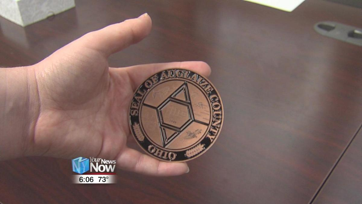 Auglaize  County Commissioners unveil 50th Anniversary medallion1.jpg