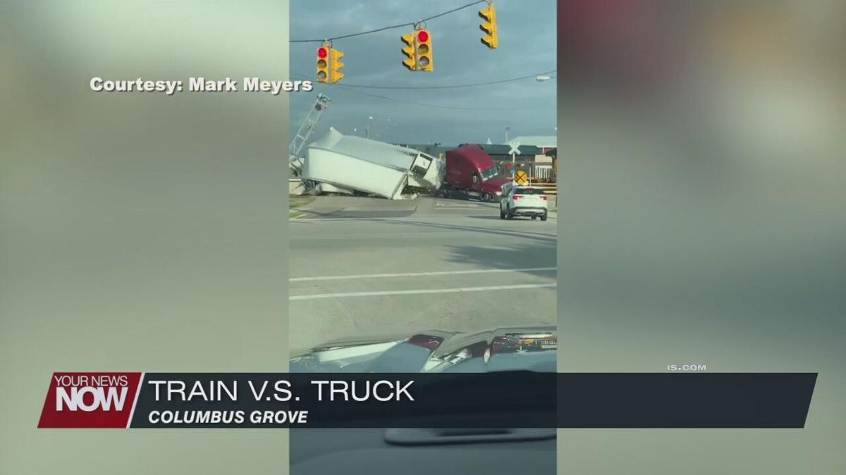 Train plows into semi, no one injured