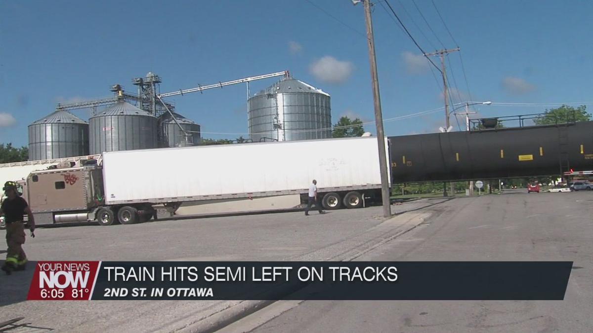 Train crashes into semi truck left on the tracks