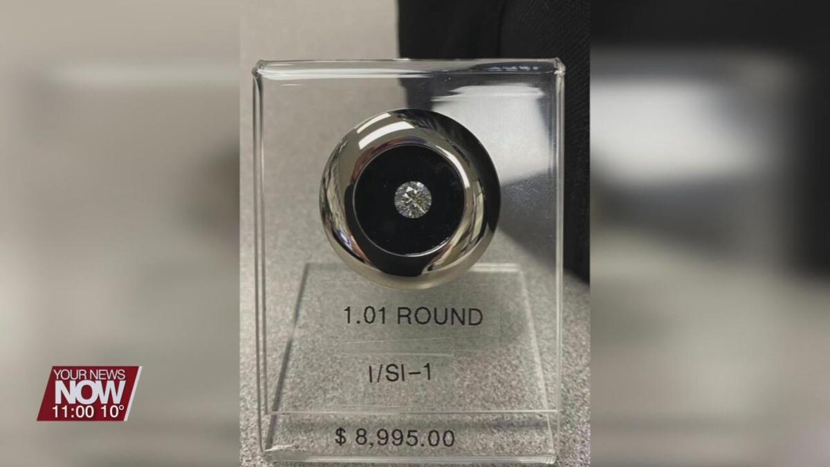 Theft of $9,000 diamond leads to arrest