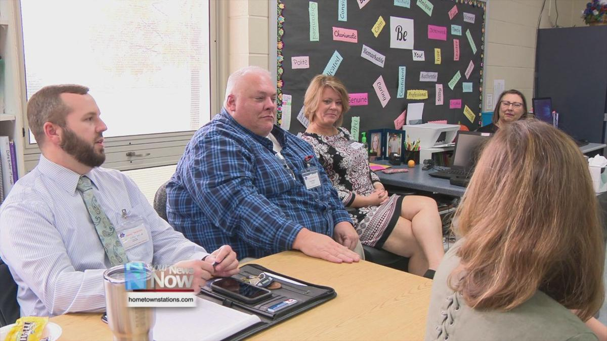 Education officials make a literacy school visit in Logan County