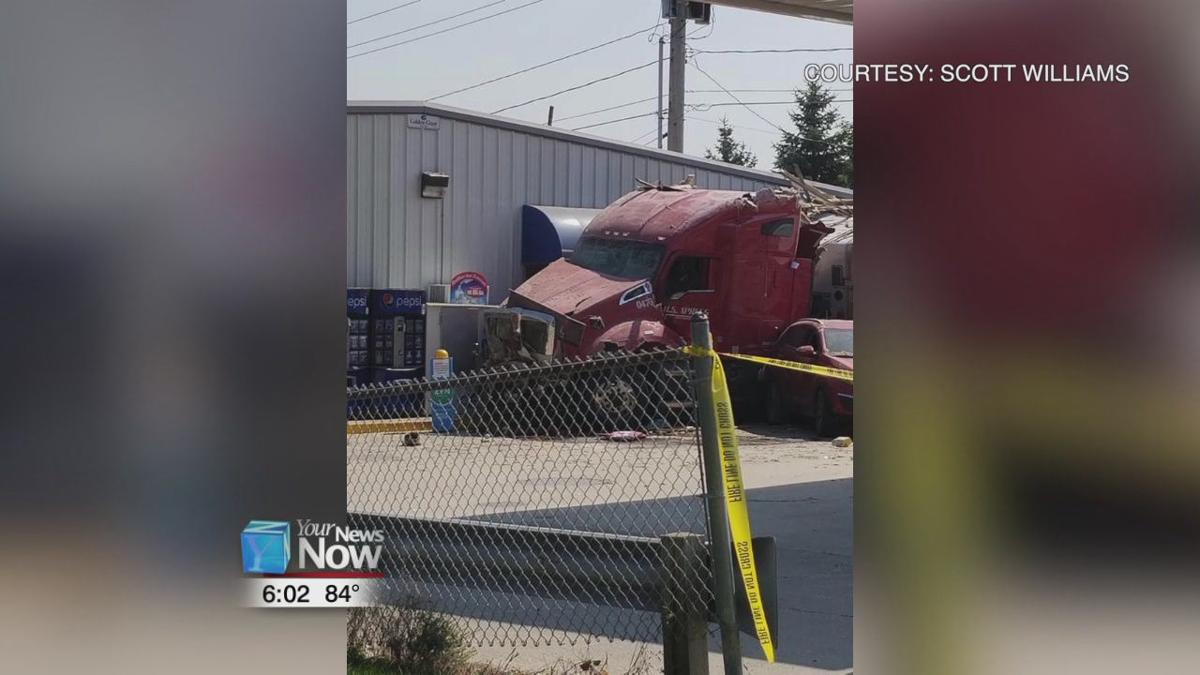 Semi truck drives through a house and crashes into gas station