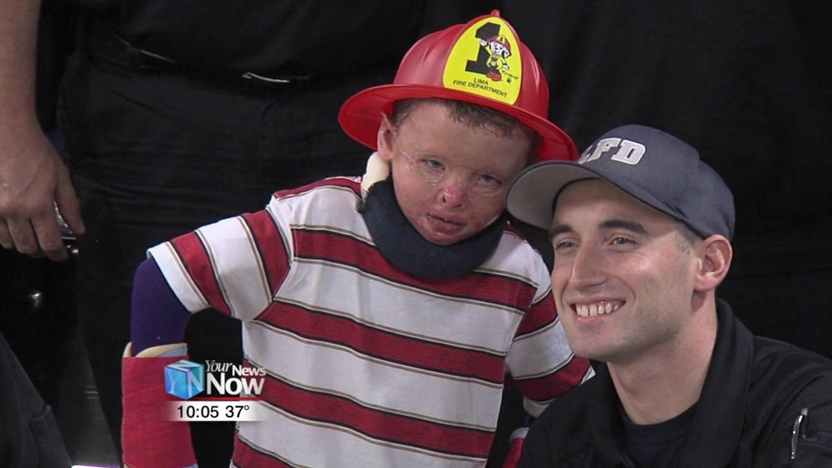 Lima Fire Department welcomes home Lima boy they rescued from fire 2.jpg