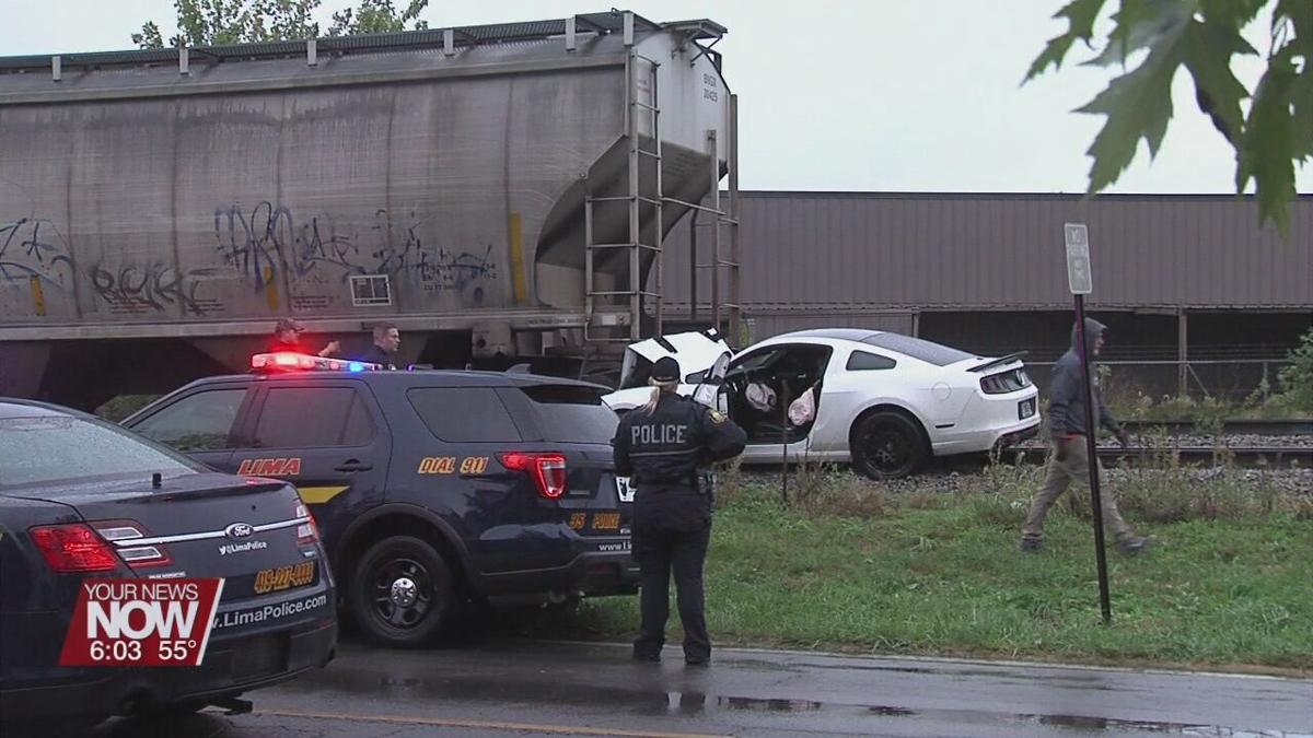 Man hospitalized after crashing car into train car