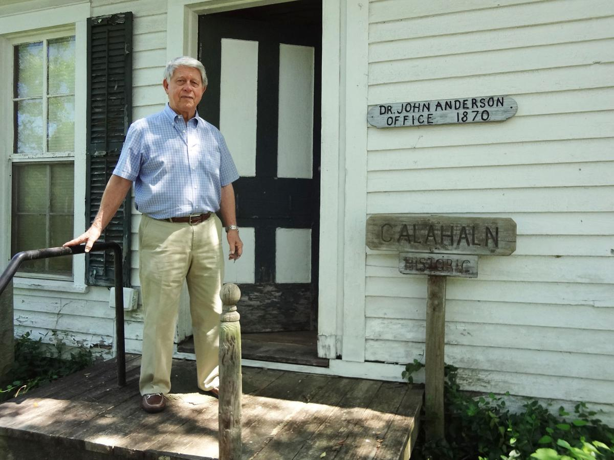 Neil Anderson poses in front of his family's small museum
