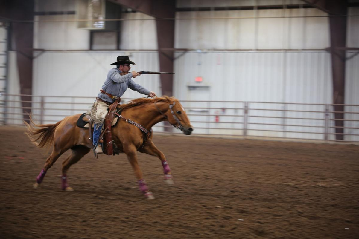 Cowboy Mounted Shooting Association competitors in action
