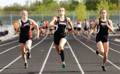 New Richmond's Dyllan Powers, center, and Angie Blinderman, will make up half of the Tiger girls' 4x400 meter relay team at the Division 1 state meet in La Crosse Saturday, June 26, while Powers will also compete in the 400 meter dash. File photo