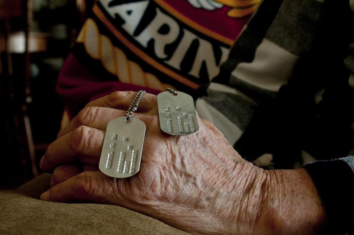 Soldier holding dog tags.jpg
