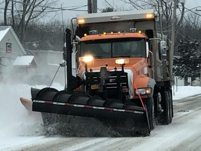 Snow, ice bear down on Twin Counties