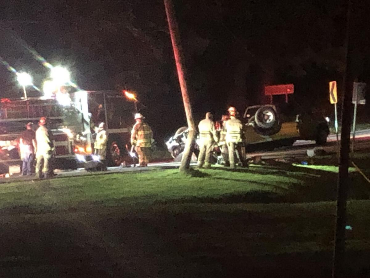 Car hits utility pole, rolls over