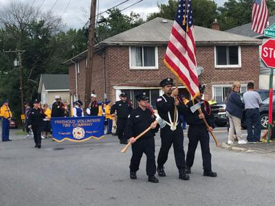 Firefighters add 9/11 memorial to parade
