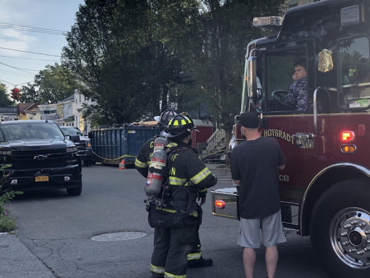 Gas leak evacuates building, closes street