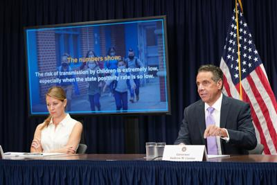 After confusion, Cuomo clarifies no masks for outside students