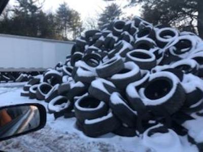 Town battles tire dump