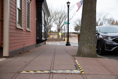 Sidewalk proposal shifts responsibility to city
