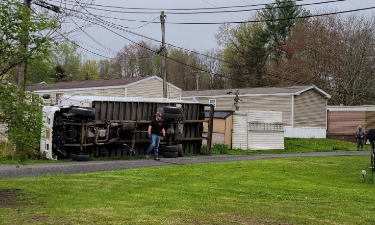 Truck rolls over, leaves mobile home park without power