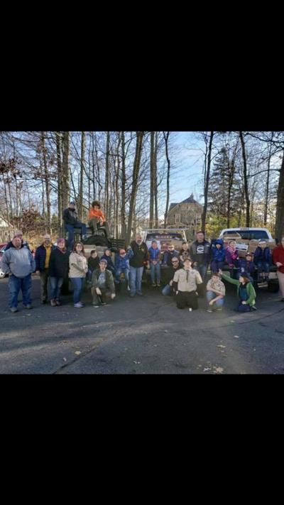 Cub Scouts and Boy Scouts team up to collect food