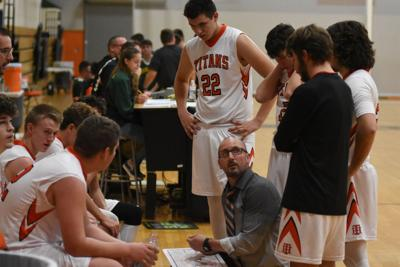 BOYS BASKETBALL: Titans edge Mustangs in OT for first win