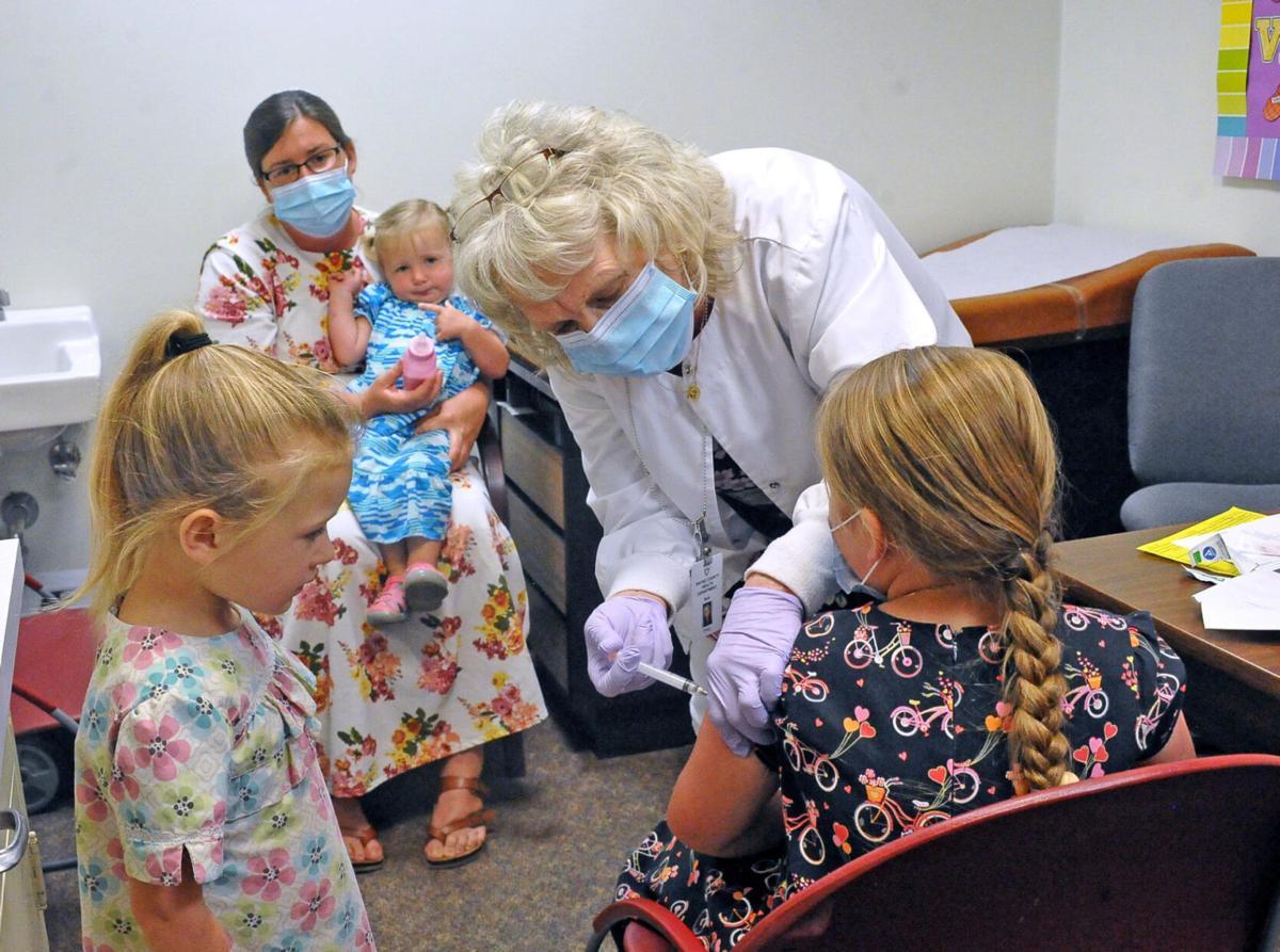 8 families join vaccine exemption suit