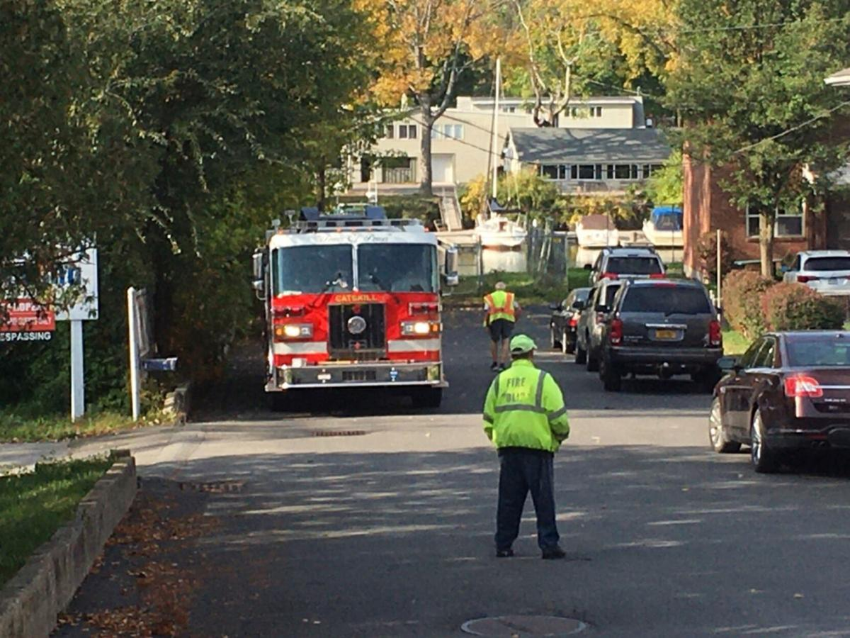 Firefighters check report of natural gas leak