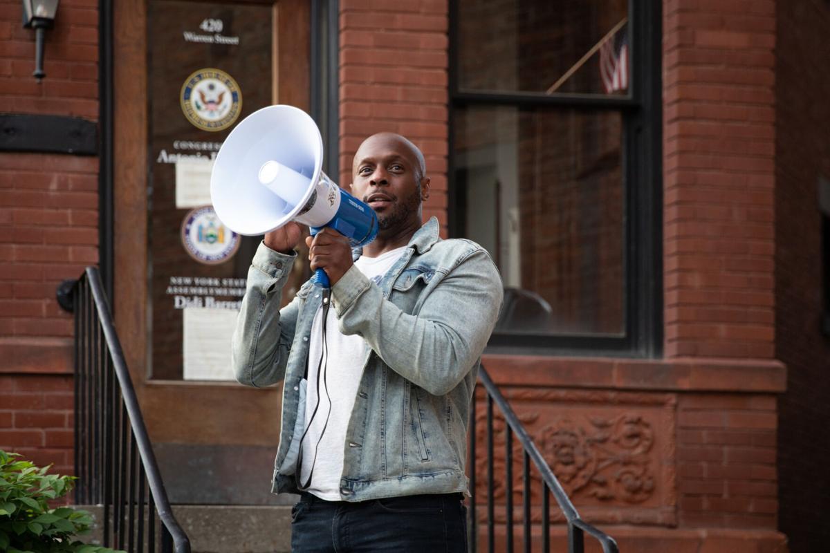 Protesters decry Hudson housing shortage at vigil