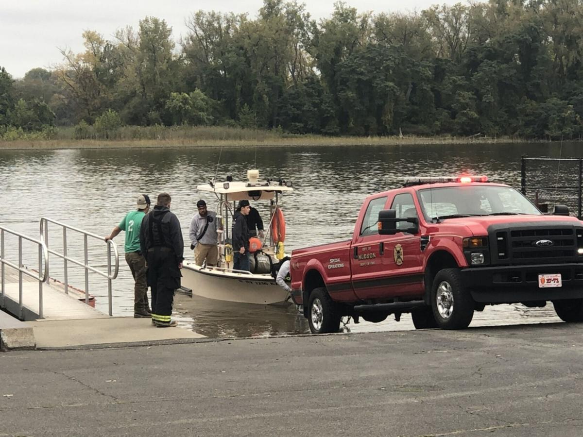 4 rescued from boat sinking in river