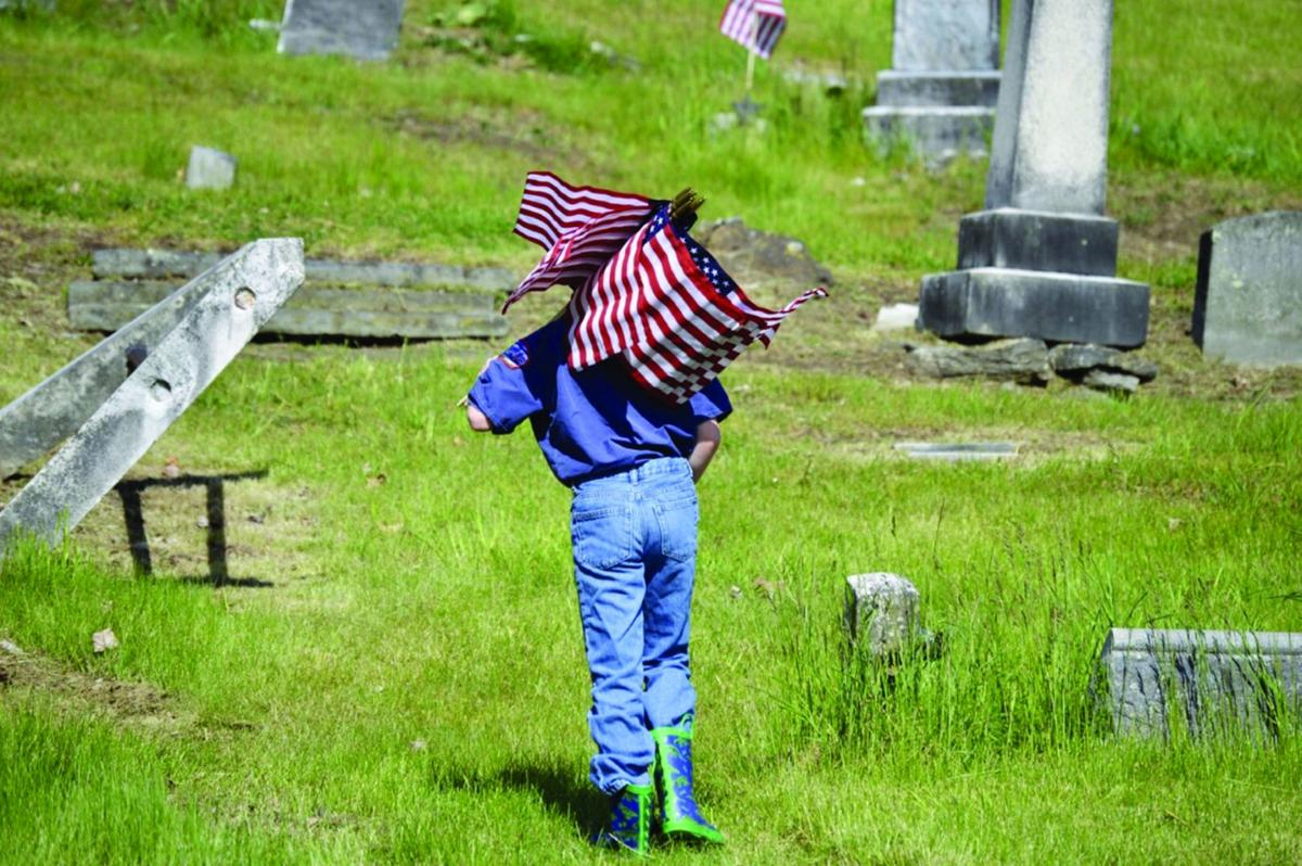 American Legion marks veterans' graves with U.S. flags