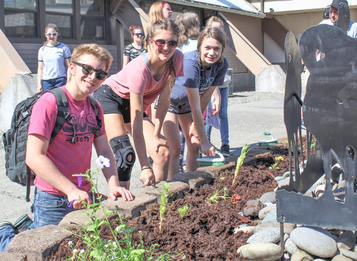 CVHS students plant flowers for Ram Pride Day photo