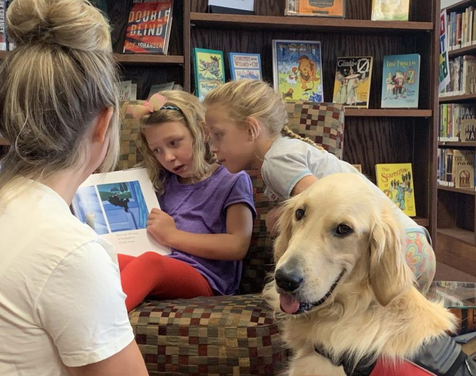 Audree Baldus reads to Wink