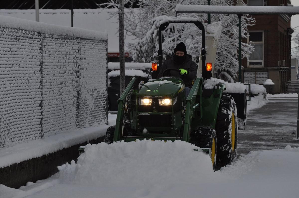Bell Equipment clears snow off sidewalk