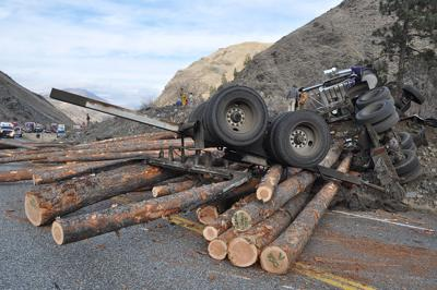 Log truck driver hurt in Monday semi-truck rollover at Pollock