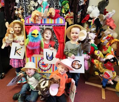 Kids with puppets photo