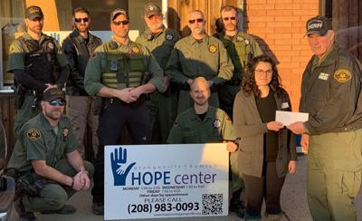 Deputies Avoid Close Shave, Donate To Charity