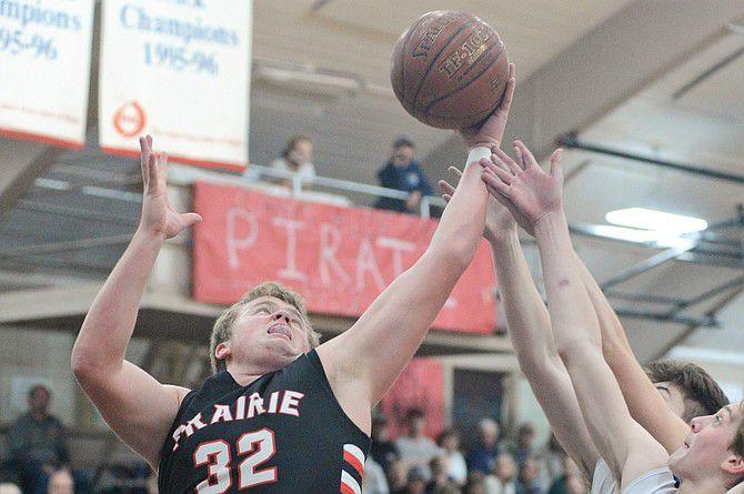 Prairie's Schumacher rebounds during the Idaho County Shootout