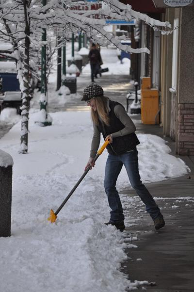 Holly Swanstrom shovels snow