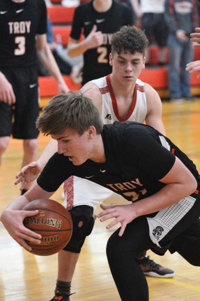 Troy escapes in overtime