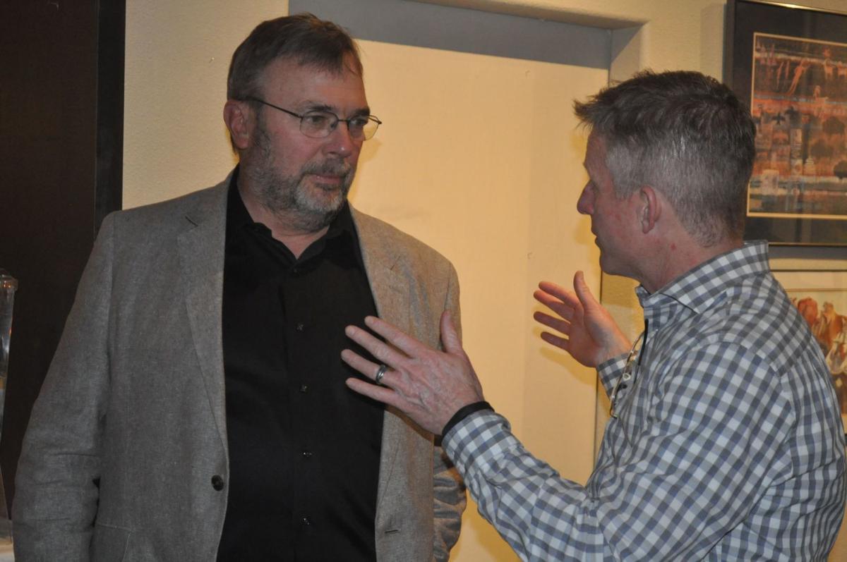 Rep. Mat Erpelding speaks with John Andrechak, chair for Idaho County Democrats