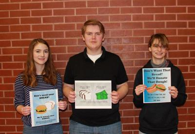 PHS students post with The Hangout posters