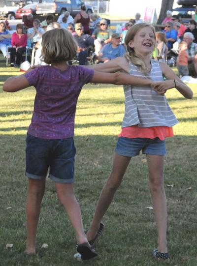 Dancing To Oldies: Girls dance at Thursday Summer Concert