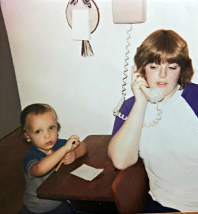 Lorie Palmer on rotary phone in 1983