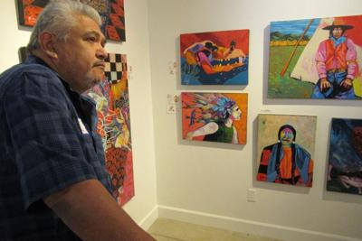 Artist Ric Gendron with samples of his work.