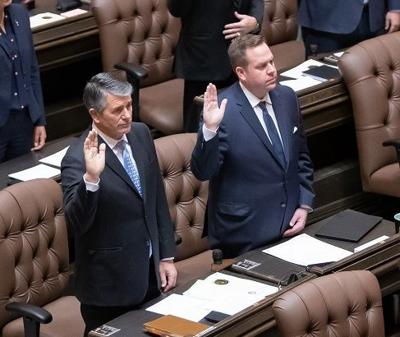 12th District Reps. Keith Goehner, left, and Mike Steele take their oath of office at the start of the 2019 legislative session.