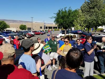 UFCW 21 members and supporters in a leaflet action outside Central Washington Hospital , July 18, 2018.