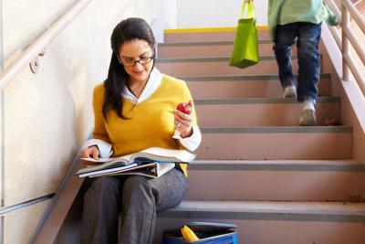 teacher reading stairs