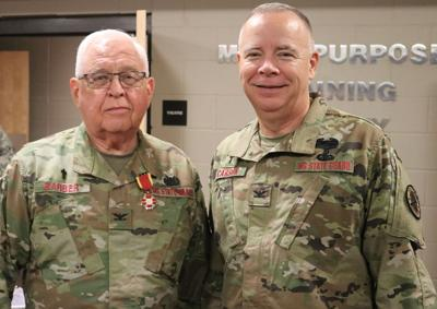 Col. Nathan Barber, left, and incoming command chaplain Col. Scott Carson.