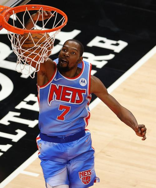 The Brooklyn Nets' Kevin Durant dunks against the Atlanta Hawks during overtime at State Farm Arena in Atlanta on Wednesday, Jan. 27, 2021.