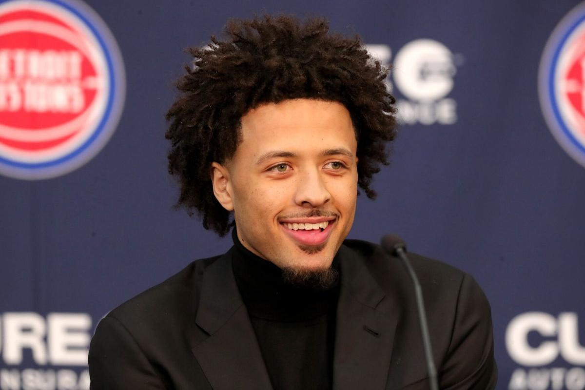 Detroit Pistons first-round draft pick Cade Cunningham answers questions from reporters after the news conference on Friday, July 30, 2021, at the team's practice facility in Detroit.