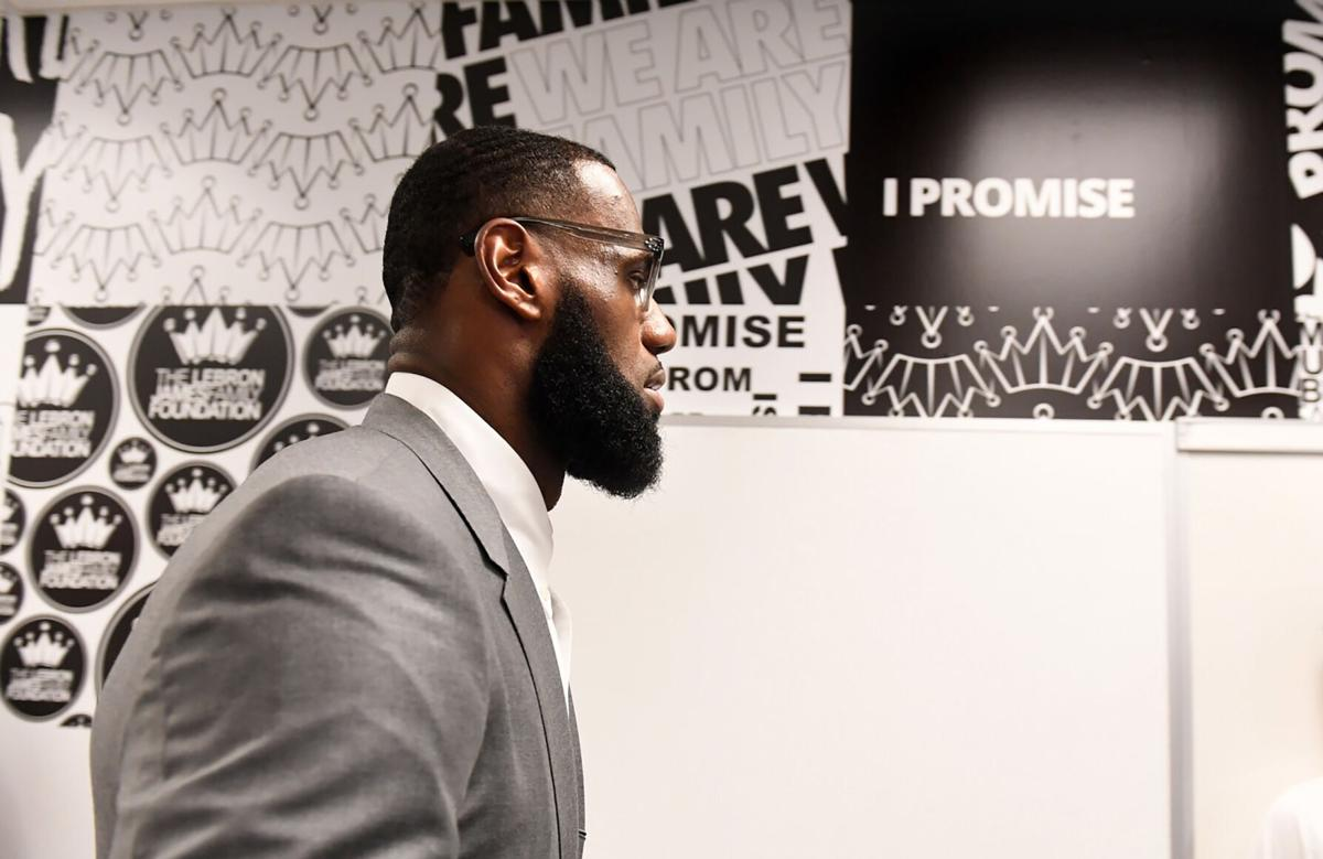 In this file photo, LeBron James prepares for a press conference in a classroom at the I PROMISE School in Akron, Ohio.