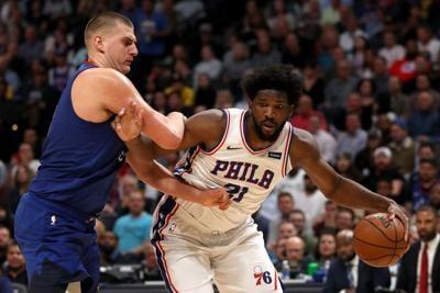 Nikola Jokic #15 of the Denver Nuggets guards Joel Embiid #21 of the Philadelphia 76 ers in the fourth quarter at the Pepsi Center on November 08, 2019 in Denver.